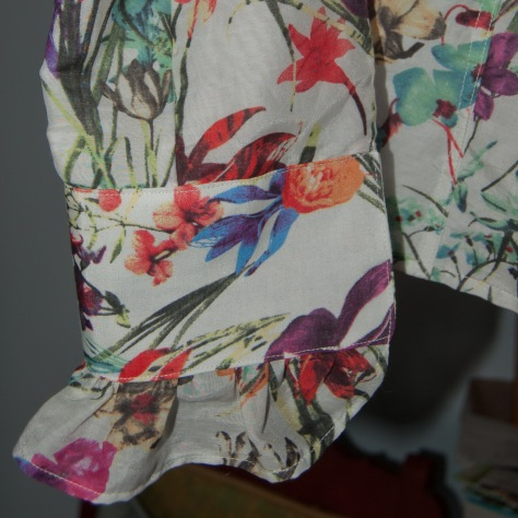 The sleeves is underlined; the cuff is interfaced; the ruffle is neither. You can see the colour variations of each.