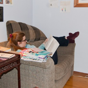 Doing what I do, when I wear jeans. Yep, that's a pile of magazines on the arm of the chair.