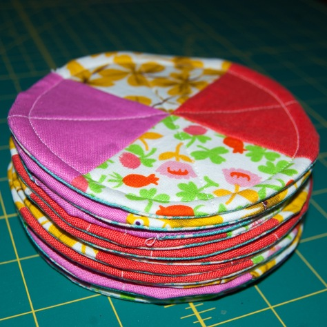 These quilted coasters have been made partially from coordinating cottons bought because they looked pretty together.